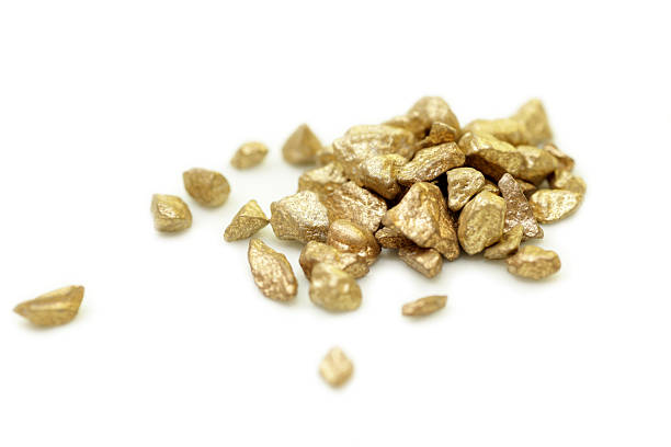 Gold nuggets isolated on white stock photo