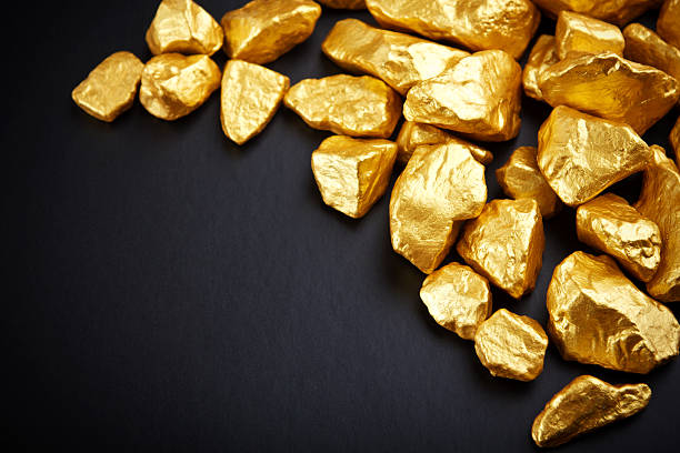 gold nuggets on a black background. closeup. stock photo