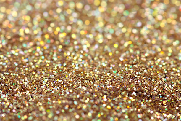 Gold nuggets sparkling carpet. Close-up view, very shallow deep stock photo