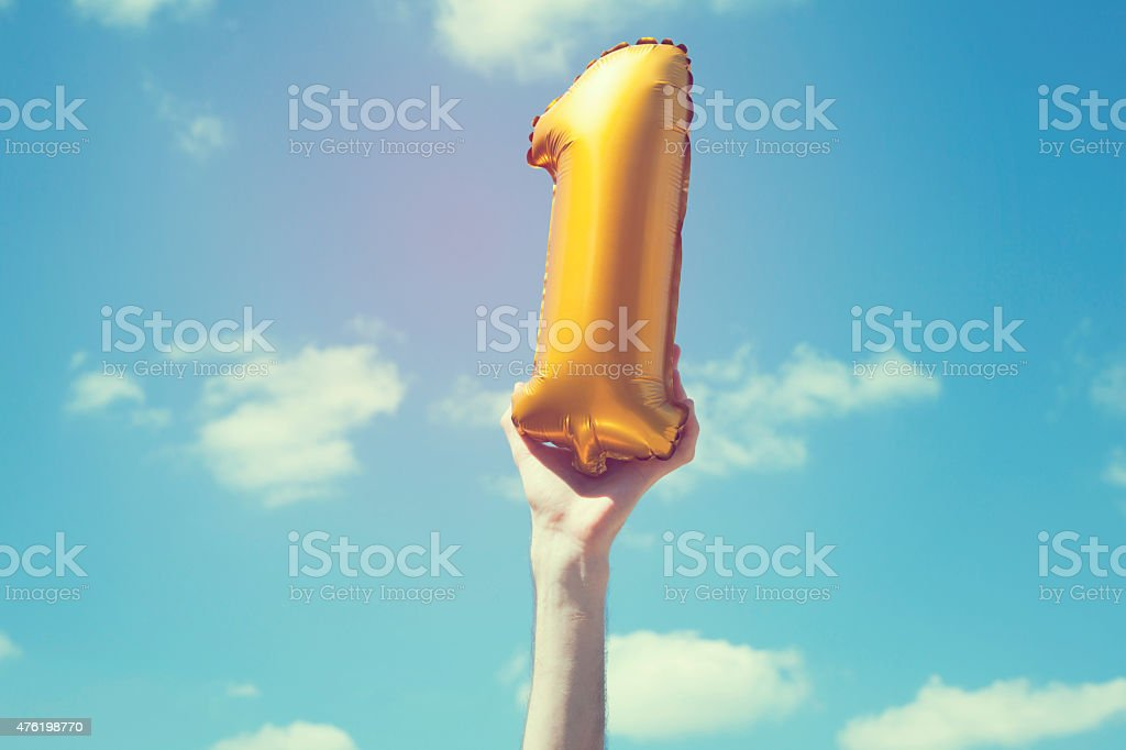 Gold number 1 balloon stock photo
