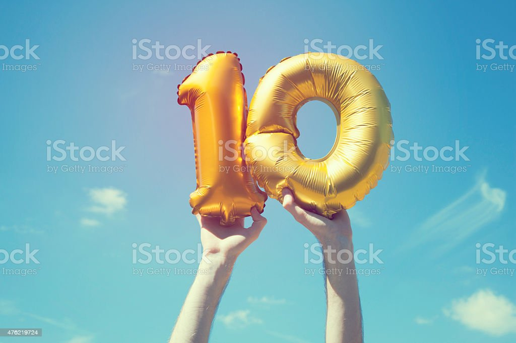 Gold number 10 balloon stock photo