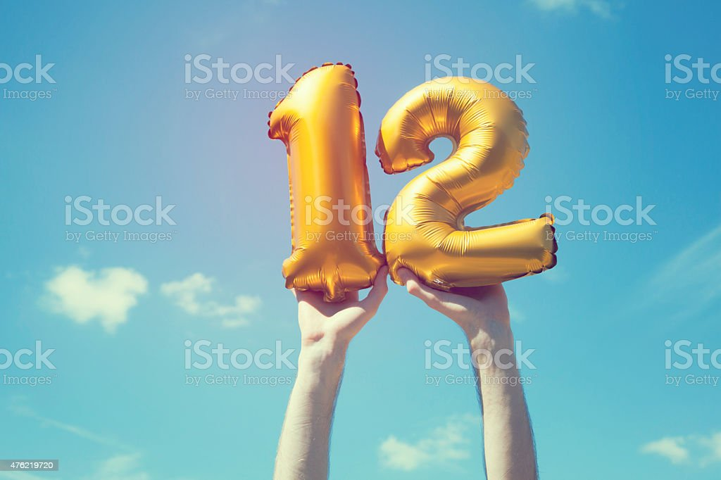 Gold Number 12 Balloon Stock Photo