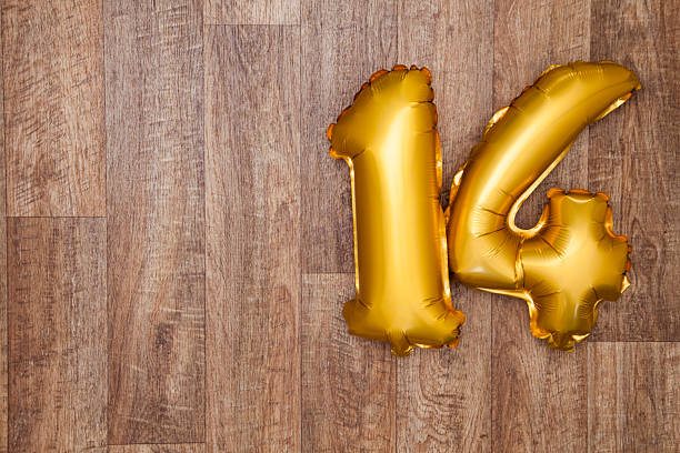 Gold number 14 balloon stock photo