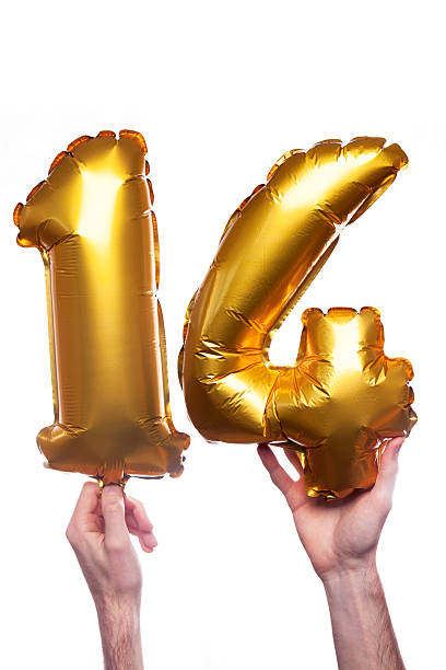 Gold number 14 balloons stock photo