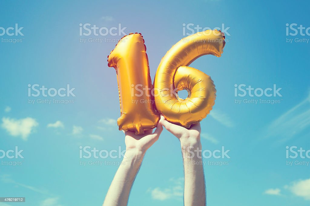 Gold number 16 balloon stock photo