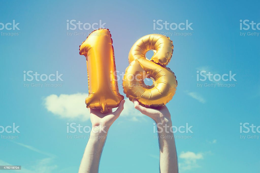 Gold number 18 balloon stock photo