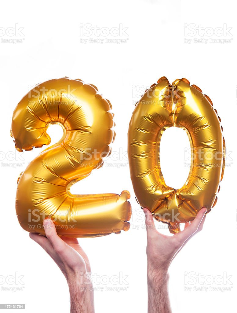 Gold number 20 balloons stock photo