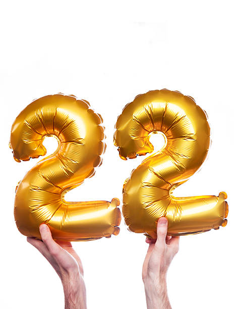 Gold number 22 balloons stock photo