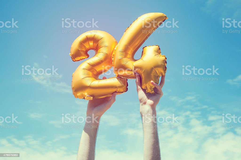 Gold number 24 balloon stock photo