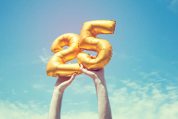 gold number 25 balloon - anniversary stock photos and pictures