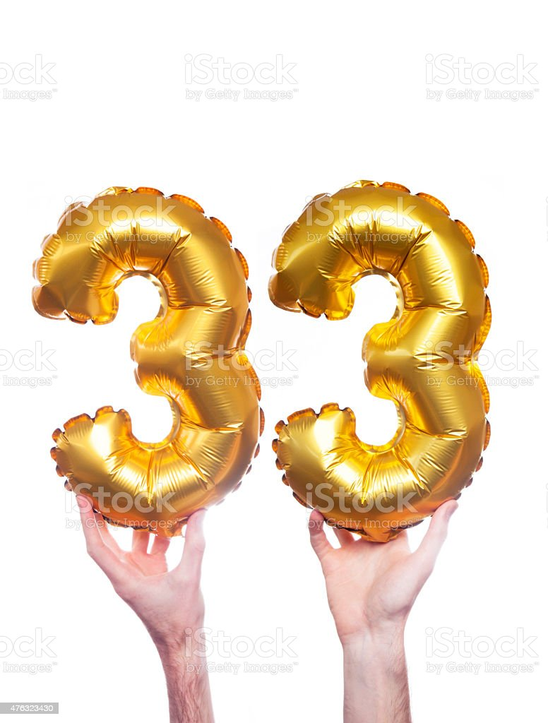 Gold number 33 balloons stock photo