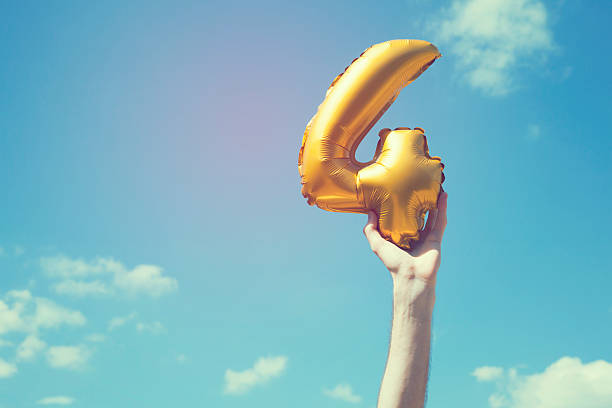 Gold number 4 balloon stock photo