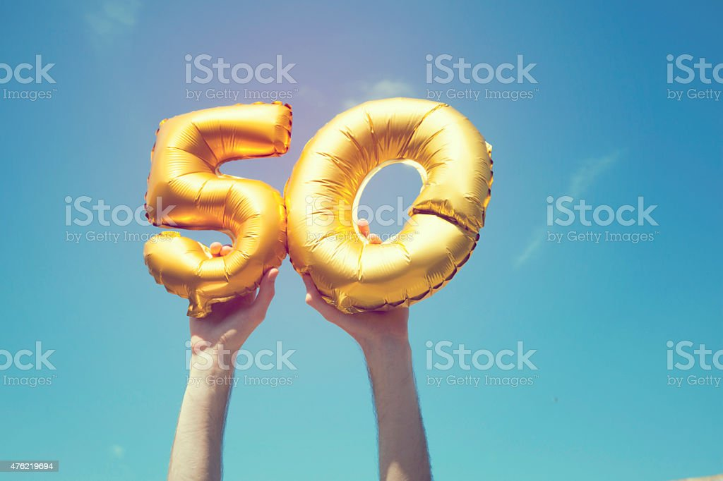 Gold number 50 balloon stock photo