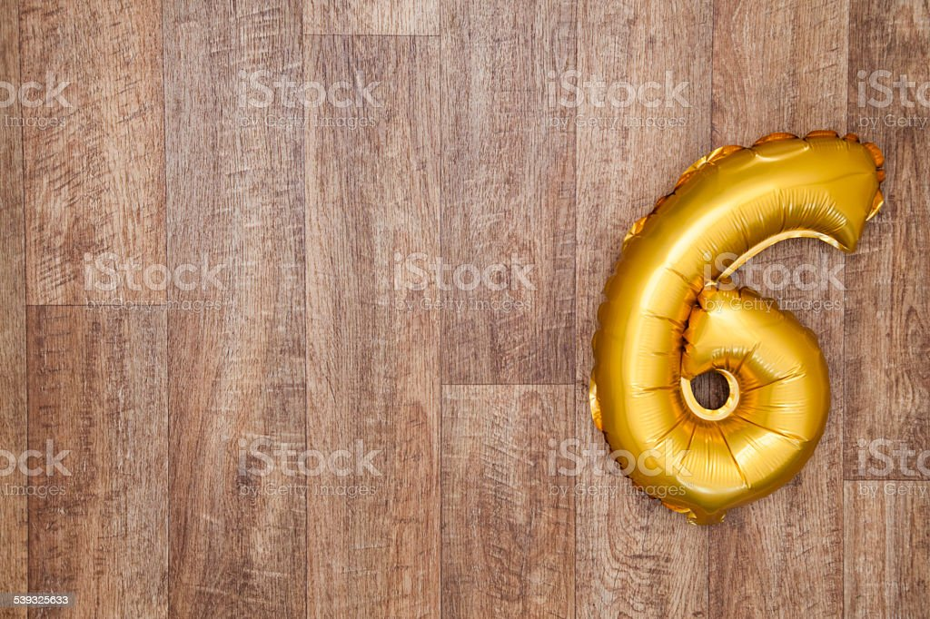 Gold number 6 balloon stock photo