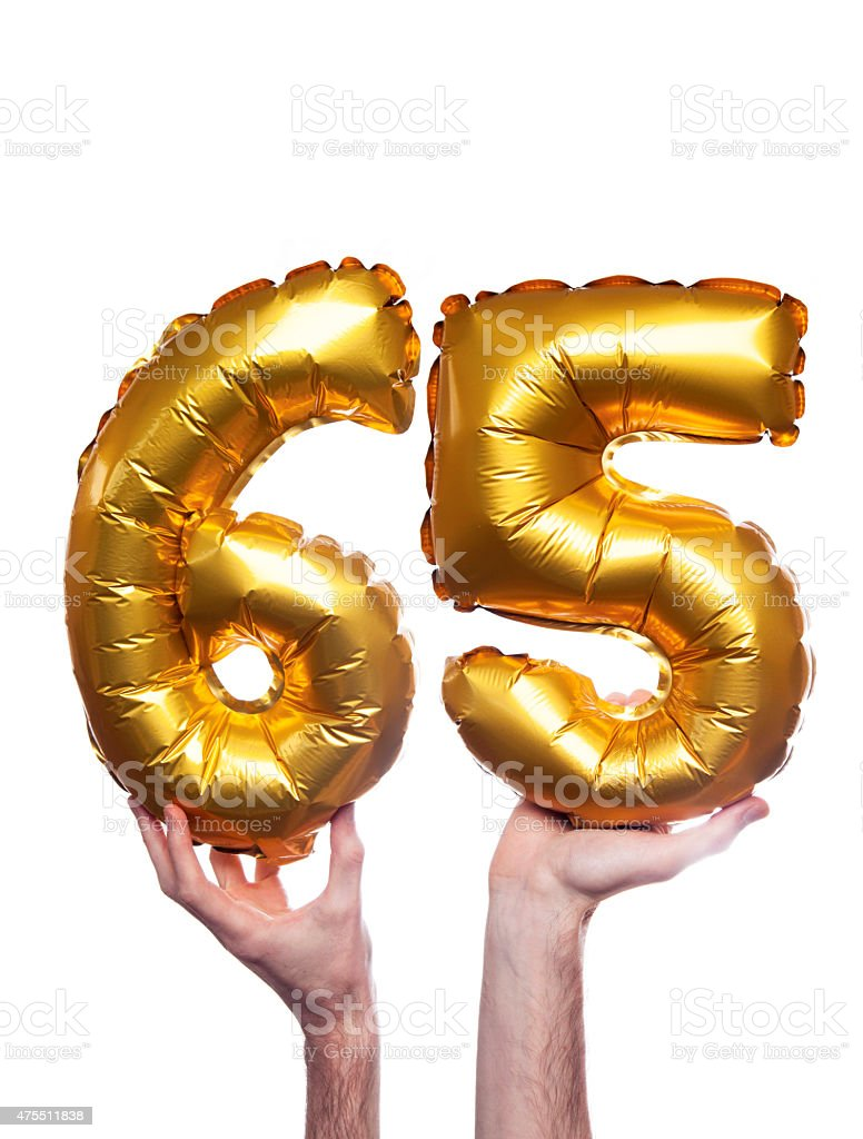 Gold number 65 balloons stock photo