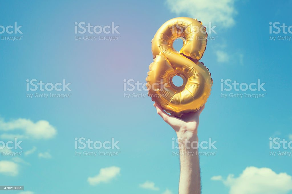 Gold number 8 balloon stock photo