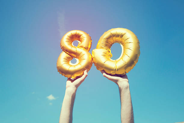 Gold number 80 balloon stock photo
