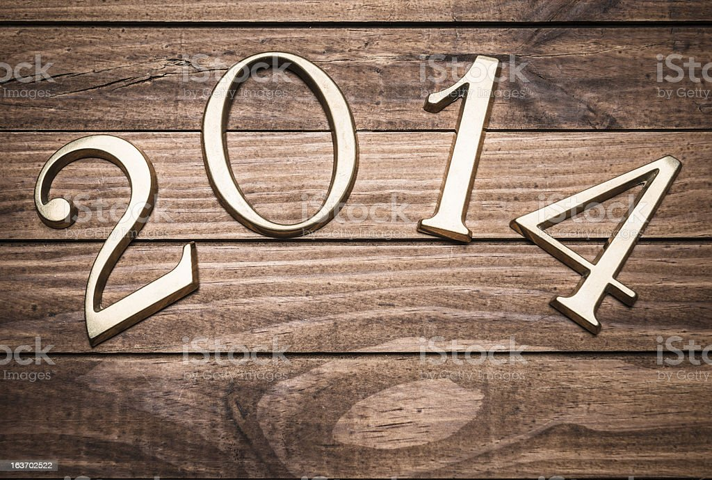 2014 gold numbers on wood background stock photo