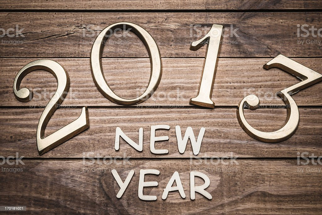 2013 gold numbers on wood background stock photo