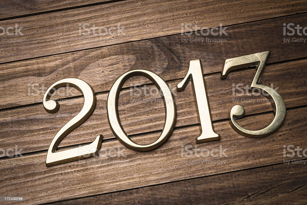 2013 gold numbers on wood background royalty-free stock photo