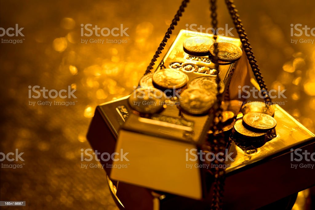 Gold on weight scale royalty-free stock photo