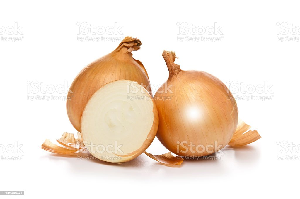 Gold onions isolated on white backdrop stock photo