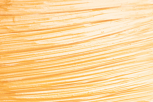 1202746861 istock photo Gold or golden glossy acrylic paint textured background. 1209926479