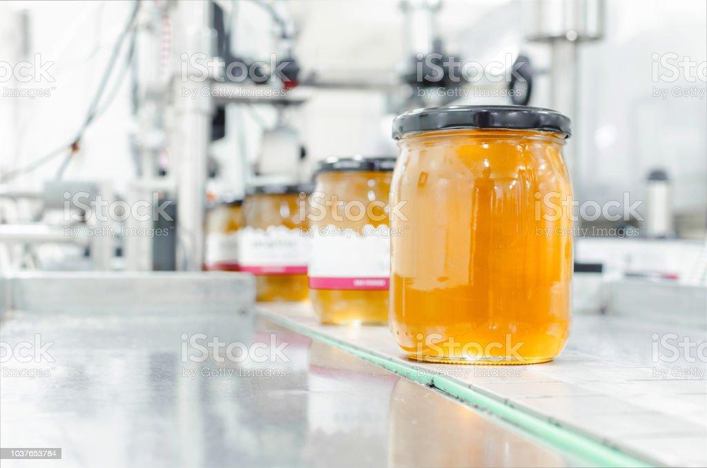 Ouro mel orgânico em jar - foto de acervo