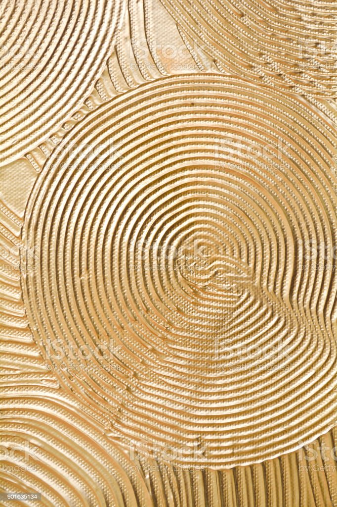 Gold paint on wooden panel stock photo