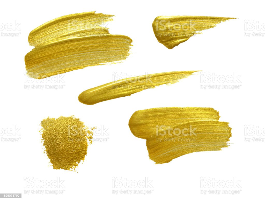 Gold paint stokes isolated on white background stock photo