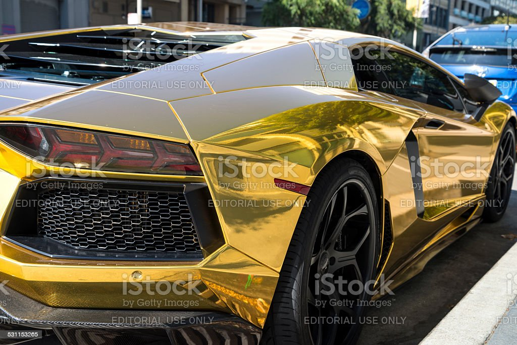 Gold Painted Lamborghini, Isolated. stock photo