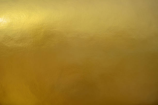 gold painted wall surface - gold stock pictures, royalty-free photos & images