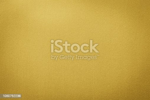 Gold colored paper with a shimmering finish texture. Gold paper texture