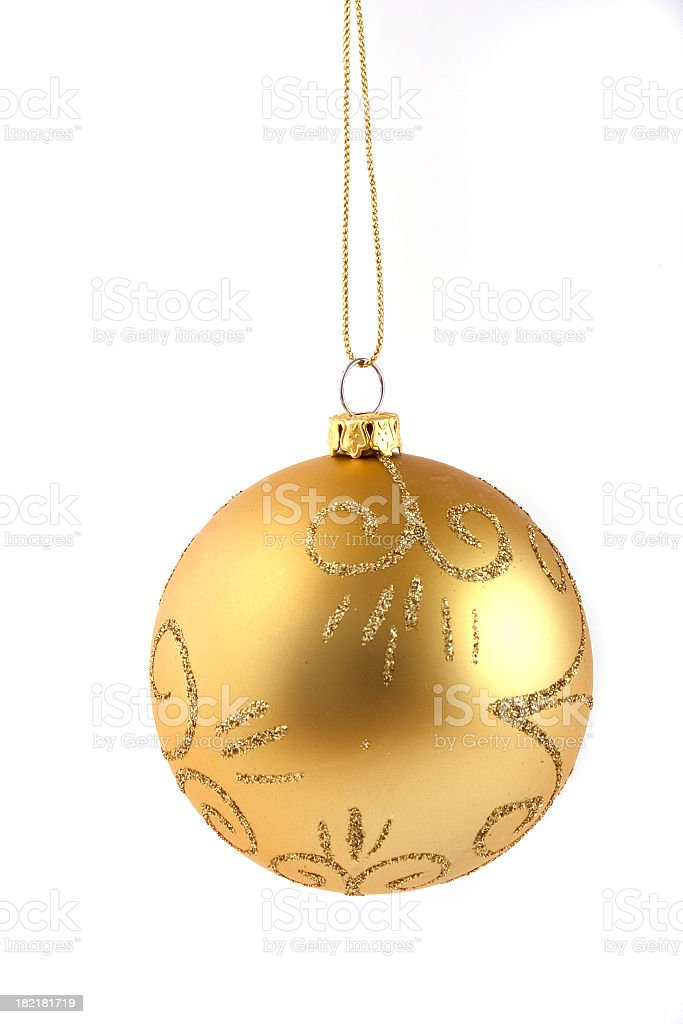 A gold patterned Christmas ball with white background stock photo