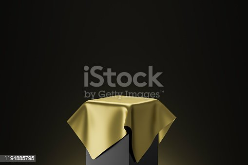 istock Gold pedestal or podium display with golden satin fabric platform concept on dark background. Blank shelf stand for showing product. 3D rendering. 1194885795