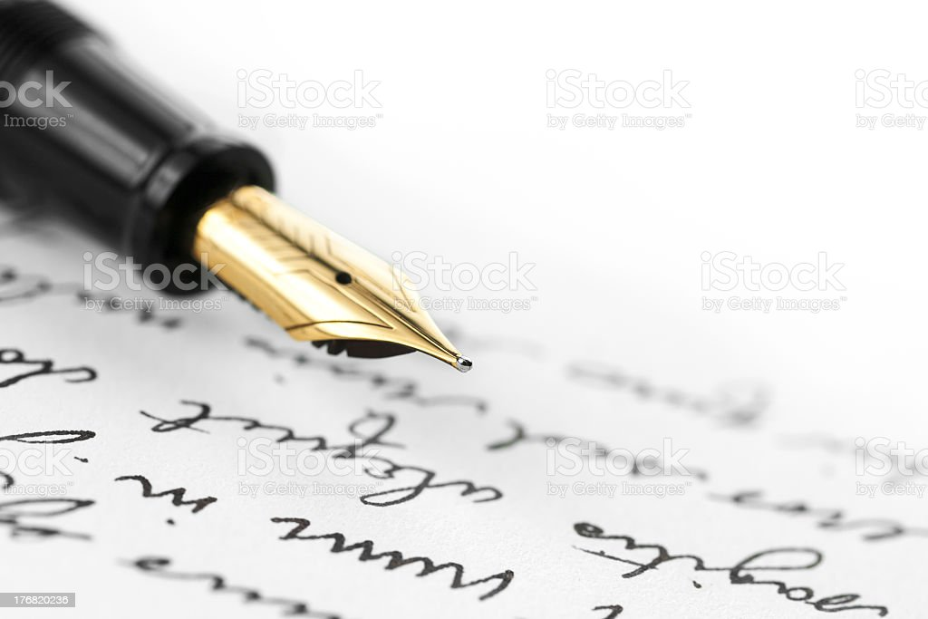 Gold pen on hand written letter Gold pen with hand written letter. Focus on end tip of fountain pen. Black Color Stock Photo