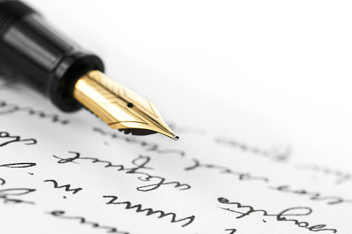 Gold Pen On Hand Written Letter Stock Photo - Download Image Now