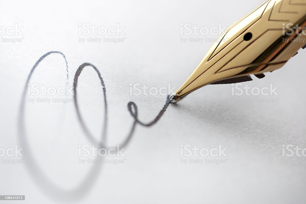 Gold pen with signature stock photo