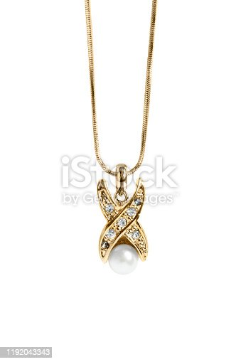 Gold pendant with crystals and single pearl hanging on white background