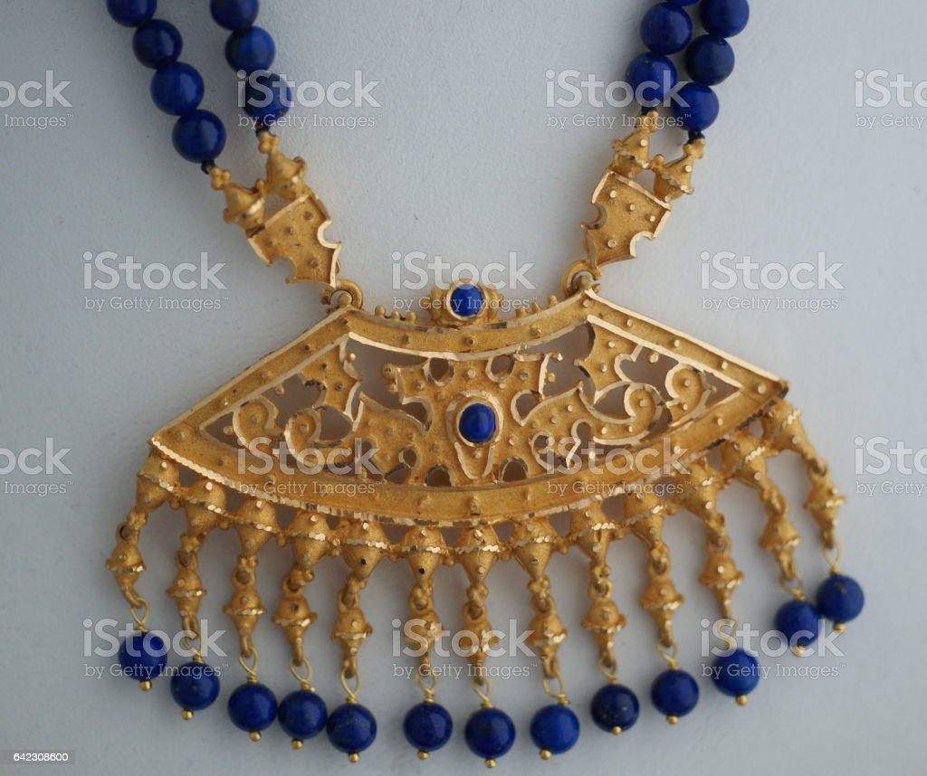 Gold Pendant with blue Sapphire beads stock photo