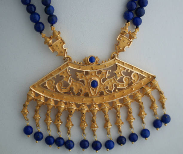 gold pendant with blue sapphire beads - filigree stock photos and pictures