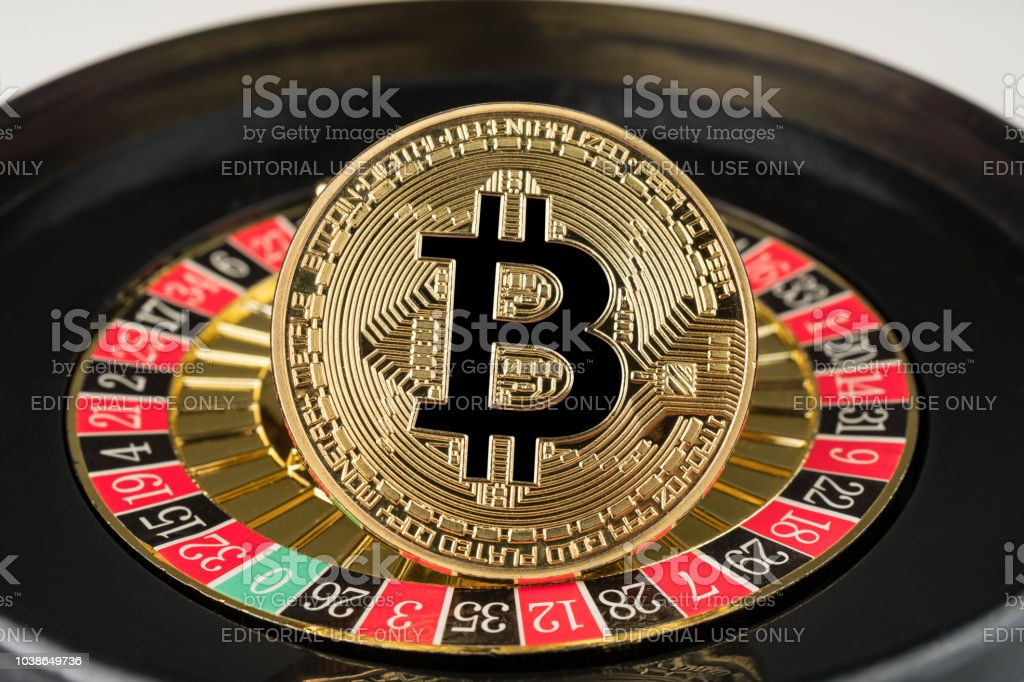 Gold physical Bitcoin coin on casino roulette. stock photo
