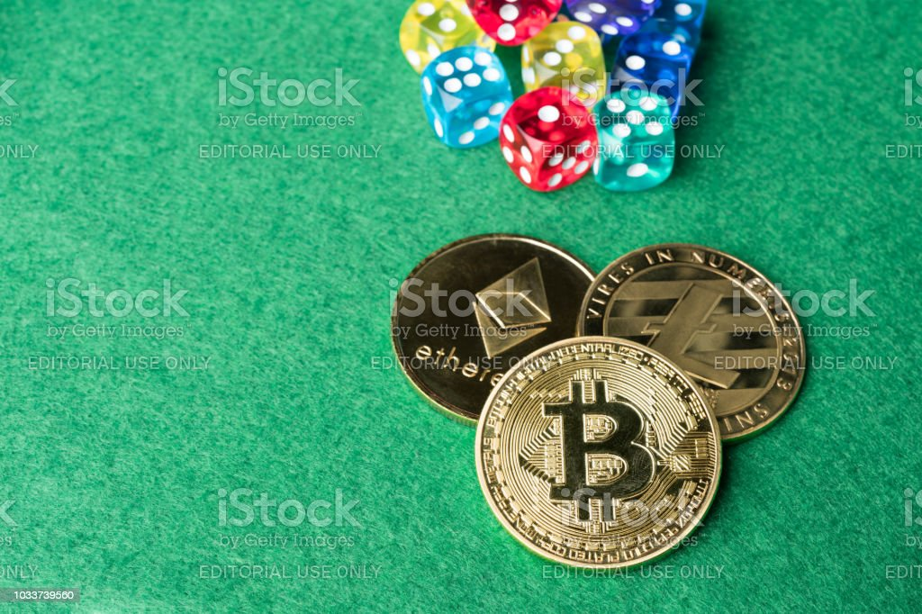 Gold physical Bitcoin, Litecoin and Ethereum coins with colorful dice. stock photo