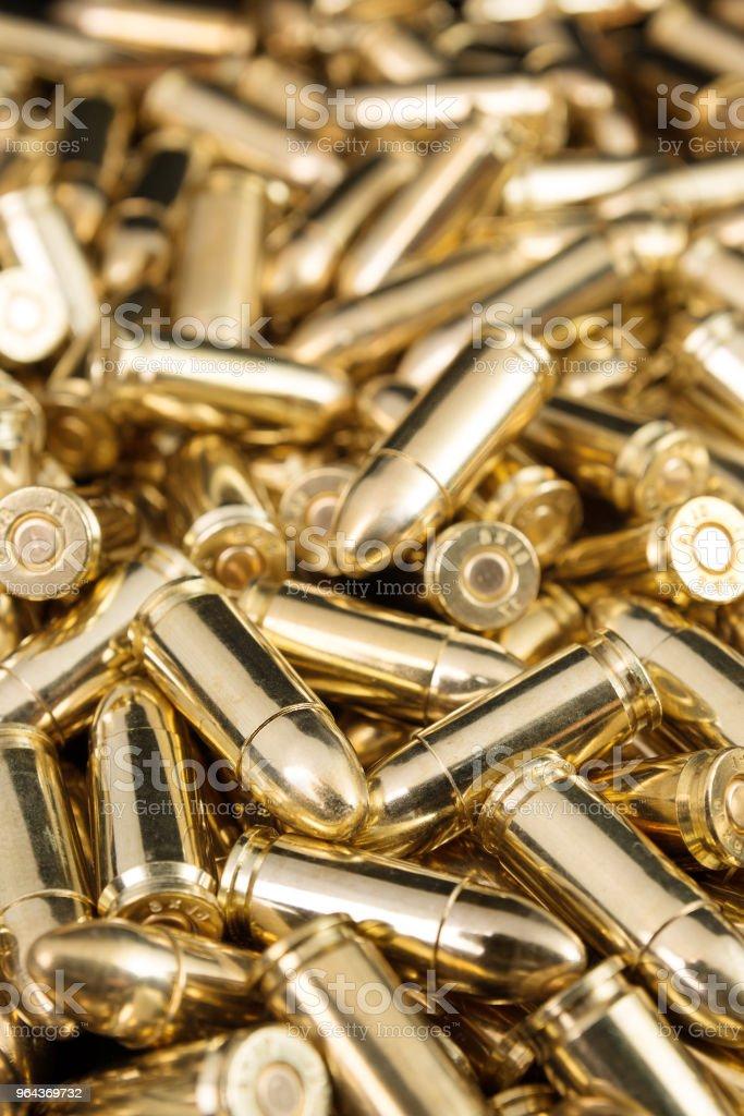 Balas da pistola de ouro - Foto de stock de Amontoamento royalty-free