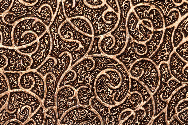 Gold plated metallic textured background with patterns. stock photo