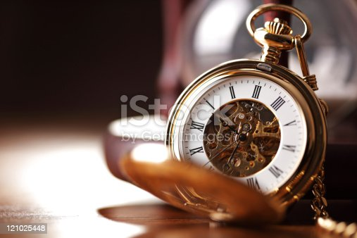 istock Gold pocket watch and hourglass 121025448