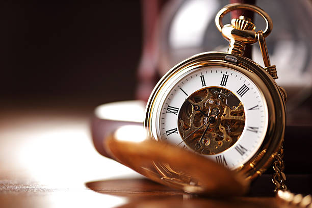 gold pocket watch and hourglass - antique stock pictures, royalty-free photos & images