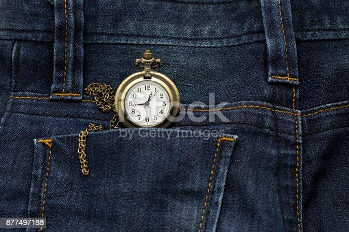 istock gold pocket watch in back pocket blue jean pants, this image for fashion 877497188