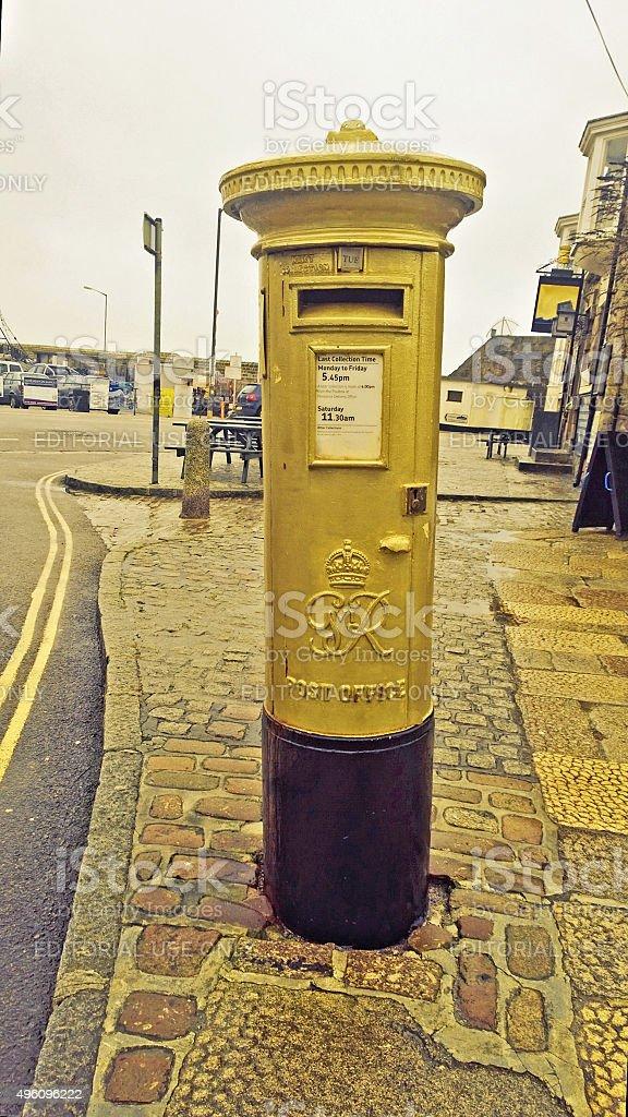 Gold postbox stock photo