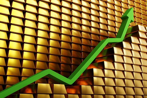 831745600 istock photo Gold prices soaring in a bullish market. Green arrow going up over gold bars. Concept digital 3D render. 1222279436